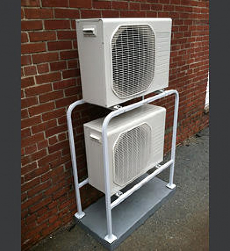 Stacking two split ac system condensers on top of each other for Ac condenser pad installation